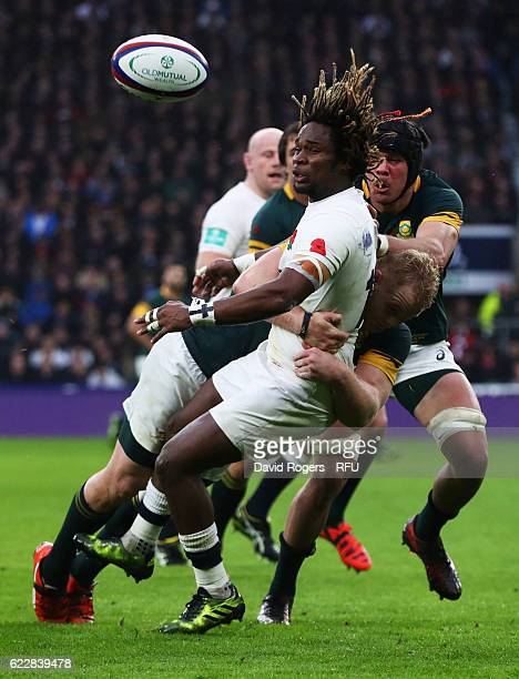 Marland Yarde of England and Vincent Koch of South Africa compete for the ball during the Old Mutual Wealth Series match between England and South...