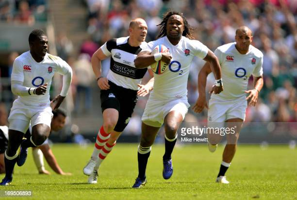 Marland Yarde of England breaks away to score his team's second try during the rugby union international match between England and The Barbarians at...