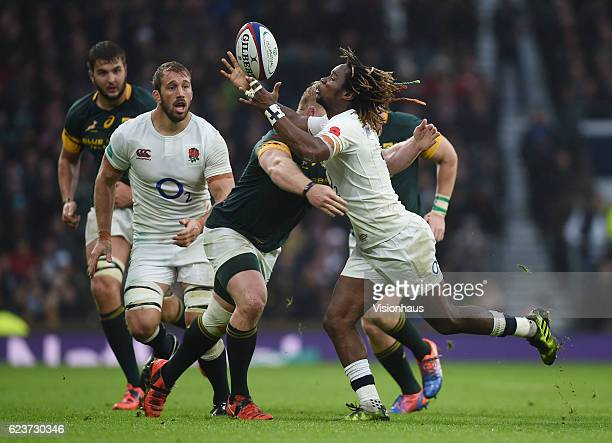Marland Yarde of England is tackled by Vincent Koch of South Africa during the Old Mutual Wealth Series match between England and South Africa at...