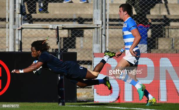 Marland Yarde of England scores England's first try during the International Test match between Argentina and England at Estadio San Juan del...