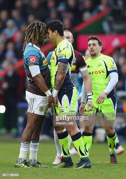 Marland Yarde of Harlequins confronts Denny Solomona of Sale Sharks after a tackle which left team mate Nick Evans of Harlequins not playing any...