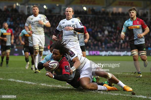 Marland Yarde of Harlequins crashes over to score his team's third try during the European Rugby Challenge Cup pool three match between Harlequins...