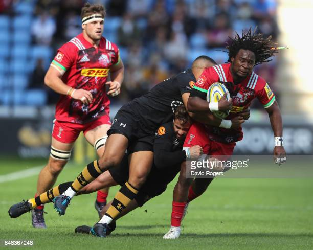 Marland Yarde of Harlequins is tackled by Marcus Watson and Danny Cipriani during the Aviva Premiership match between Wasps and Harlequins at The...