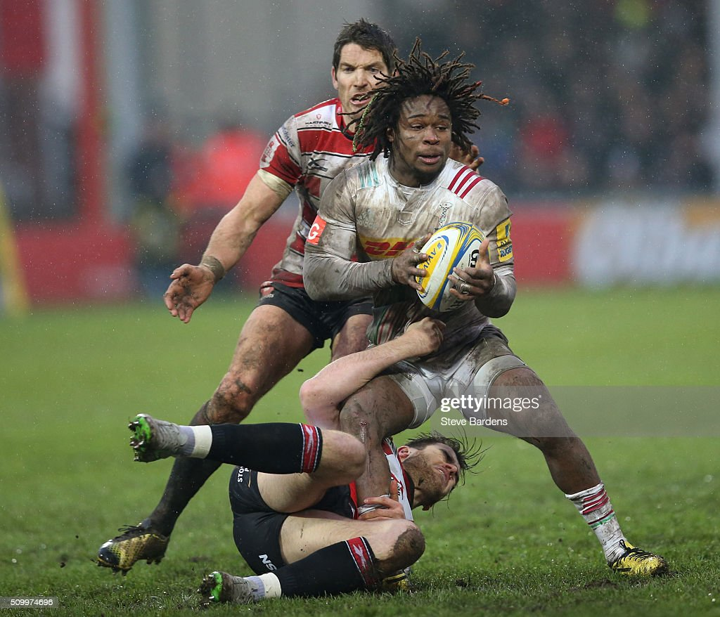 <a gi-track='captionPersonalityLinkClicked' href=/galleries/search?phrase=Marland+Yarde&family=editorial&specificpeople=6587696 ng-click='$event.stopPropagation()'>Marland Yarde</a> of Harlequins is tackled by Mark Atkinson and <a gi-track='captionPersonalityLinkClicked' href=/galleries/search?phrase=James+Hook&family=editorial&specificpeople=710391 ng-click='$event.stopPropagation()'>James Hook</a> of Gloucester Rugby during the Aviva Premiership match between Gloucester Rugby and Harlequins at Kingsholm Stadium on February 13, in Gloucester, England.