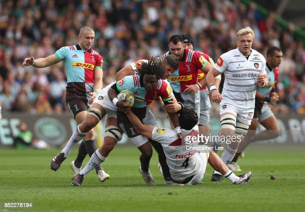 Marland Yarde of Harlequins is tackled by Mike Williams of Leicester Tigers and Harry Wells of Leicester Tigers during the Aviva Premiership match...