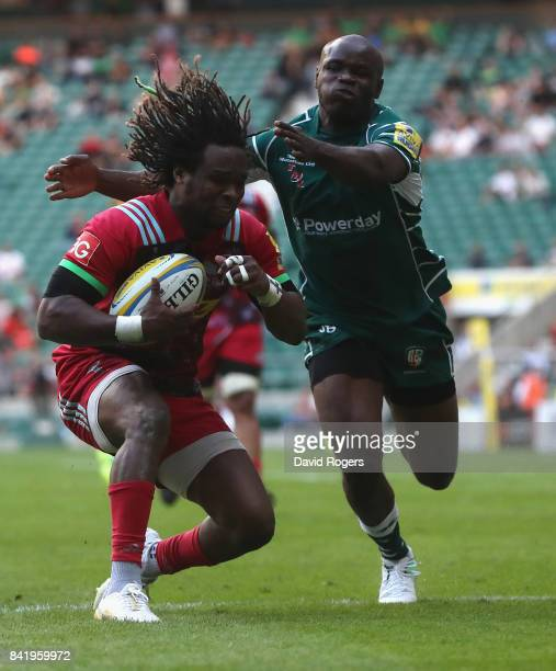 Marland Yarde of Harlequins is tackled by Topsy Ojo during the Aviva Premiership match between London Irish and Harlequins at Twickenham Stadium on...