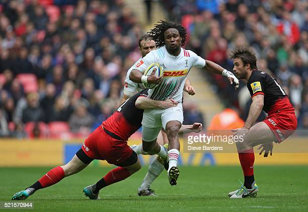 Marland Yarde of Harlequins is tackled Duncan Taylor of Saracens during the Aviva Premiership match between Saracens and Harlequins at Wembley...