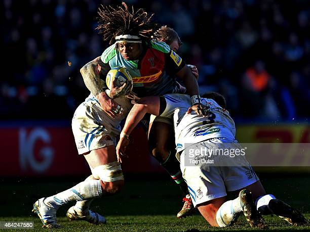 Marland Yarde of Harlequins is tackled during the Aviva Premiership match between Harlequins and Exeter Chiefs at the Twickenham Stoop on February 21...