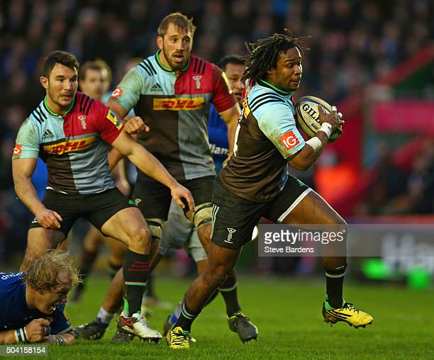 Marland Yarde of Harlequins makes a break during the Aviva Premiership match between Harlequins and Saracens at Twickenham Stoop on January 9 2016 in...