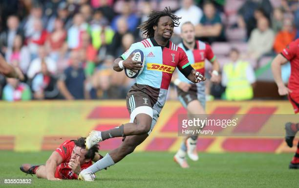 Marland Yarde of Harlequins runs towards the try line the pre season match between Harlequins and Jersey Red at the Twickenham Stoop on August 19...