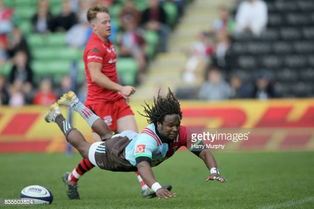 Marland Yarde of Harlequins scores his teams third try during the pre season match between Harlequins and Jersey Red at the Twickenham Stoop on...