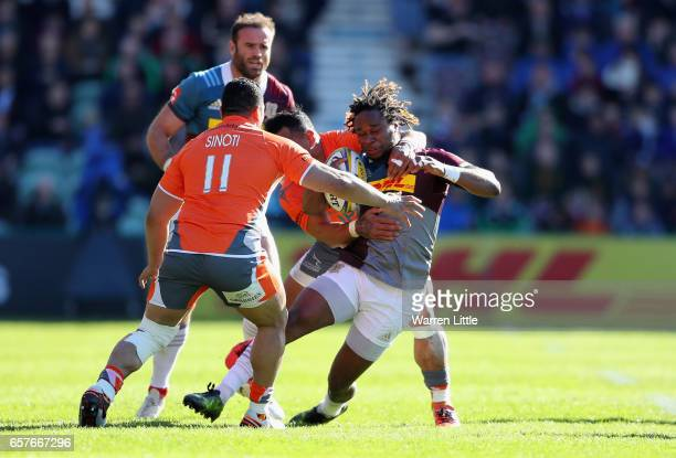 Marland Yarde of Hatlequins is high tackled during the Aviva Premiership match between Harlequins and Newcastle Falcons at Twickenham Stoop on March...