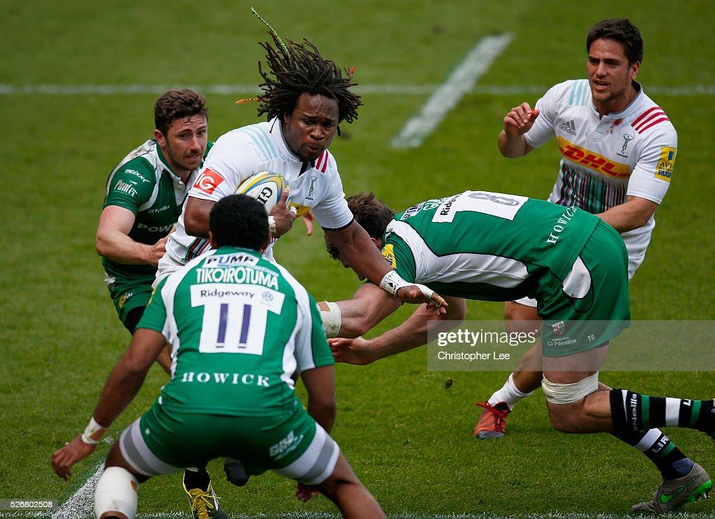 <a gi-track='captionPersonalityLinkClicked' href=/galleries/search?phrase=Marland+Yarde&family=editorial&specificpeople=6587696 ng-click='$event.stopPropagation()'>Marland Yarde</a> of Quins takes on Aseli Tikoirotuma and Tom Guest of Irish during the Aviva Premiership match between London Irish and Harlequins at the Madejski Stadium on 1 May, 2016 in Reading, England.