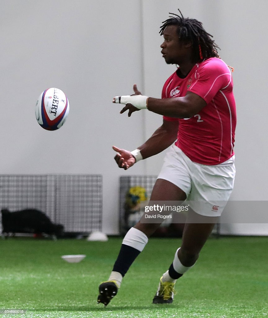 <a gi-track='captionPersonalityLinkClicked' href=/galleries/search?phrase=Marland+Yarde&family=editorial&specificpeople=6587696 ng-click='$event.stopPropagation()'>Marland Yarde</a> passes the ball during the England training session held at Pennyhill Park on May 27, 2016 in Bagshot, England.