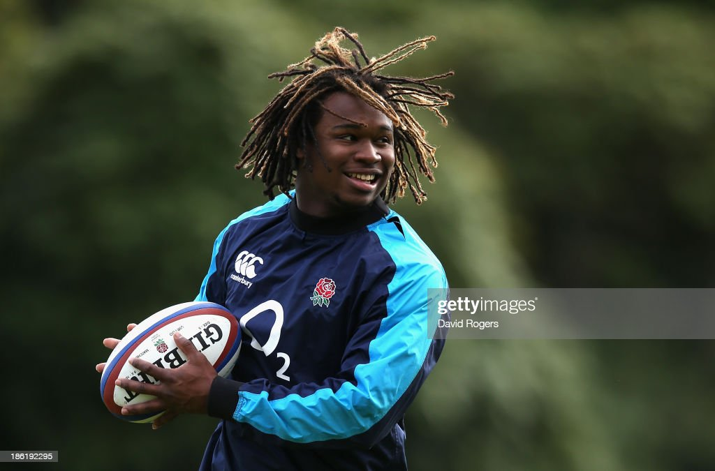 Marland Yarde runs with the ball during the England training session held at Pennyhill Park on October 29, 2013 in Bagshot, England.