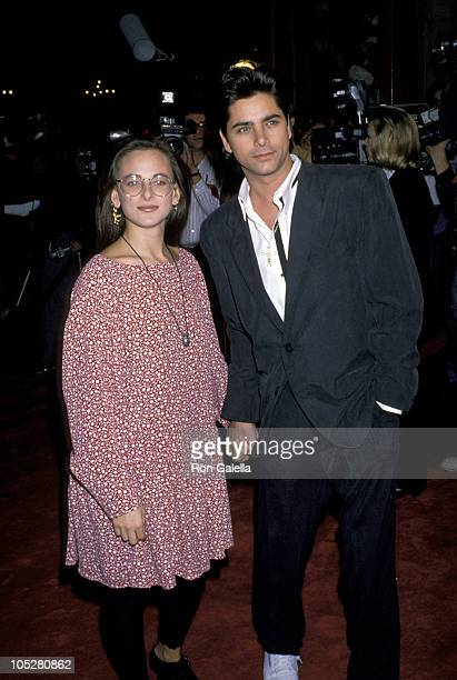 Marlee Matlin and John Stamos during 'Harlem Nights' Los Angeles Premiere November 16 1989 at Mann's Chinese Theater in Hollywood California United...