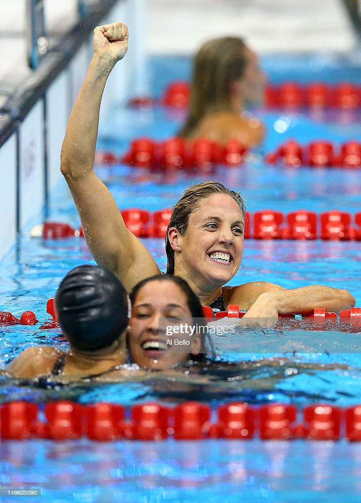 <a gi-track='captionPersonalityLinkClicked' href=/galleries/search?phrase=Marleen+Veldhuis&family=editorial&specificpeople=167185 ng-click='$event.stopPropagation()'>Marleen Veldhuis</a> of Netherlands celebrates finishing third as <a gi-track='captionPersonalityLinkClicked' href=/galleries/search?phrase=Ranomi+Kromowidjojo&family=editorial&specificpeople=4209840 ng-click='$event.stopPropagation()'>Ranomi Kromowidjojo</a> of Netherlands (first) embraces <a gi-track='captionPersonalityLinkClicked' href=/galleries/search?phrase=Aliaksandra+Herasimenia&family=editorial&specificpeople=2077479 ng-click='$event.stopPropagation()'>Aliaksandra Herasimenia</a> of Belarus (second place) following the Women's 50m Freestyle Final on Day 8 of the London 2012 Olympic Games at the Aquatics Centre on August 4, 2012 in London, England.