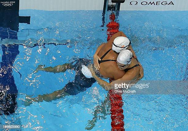 Marleen Veldhuis of Netherlands congratulates Ranomi Kromowidjojo of Netherlands on winning the Women's 50m Freestyle Final on Day 8 of the London...