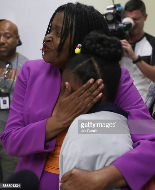 Marleine Bastien the executive director of Haitian Women of Miami hugs a 10yearold girl who was afraid to have name used and her face shown while...