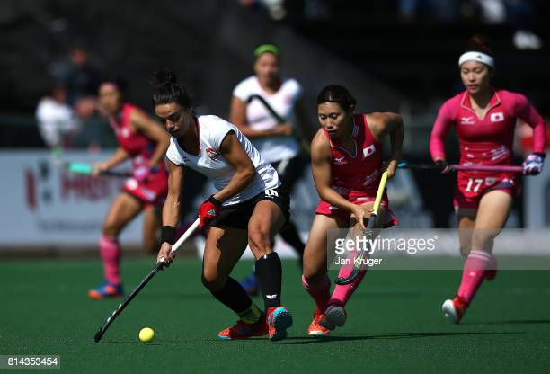 Marlena Rybacha of Poland and Yuri Nagai of Japan battle for possession during day 4 of the FIH Hockey World League Semi Finals Pool B match between...