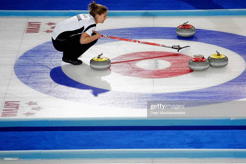 Marlene Albrecht of Switzerland lines up the stones in the match between Switzerland and Russia during Day 3 of the Titlis Glacier Mountain World Women's Curling Championship at the Volvo Sports Centre on March 18, 2013 in Riga, Latvia.