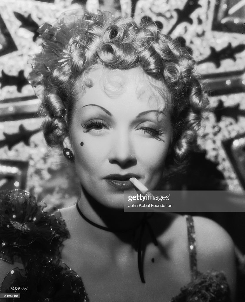 Marlene Dietrich ( 1901 - 1992) as Frenchy in a scene from the film 'Destry Rides Again', directed by George Marshall.