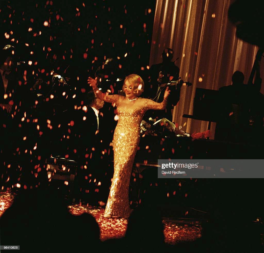 Marlene Dietrich performs on stage in London in 1975. Image is part of David Redfern Premium Collection.