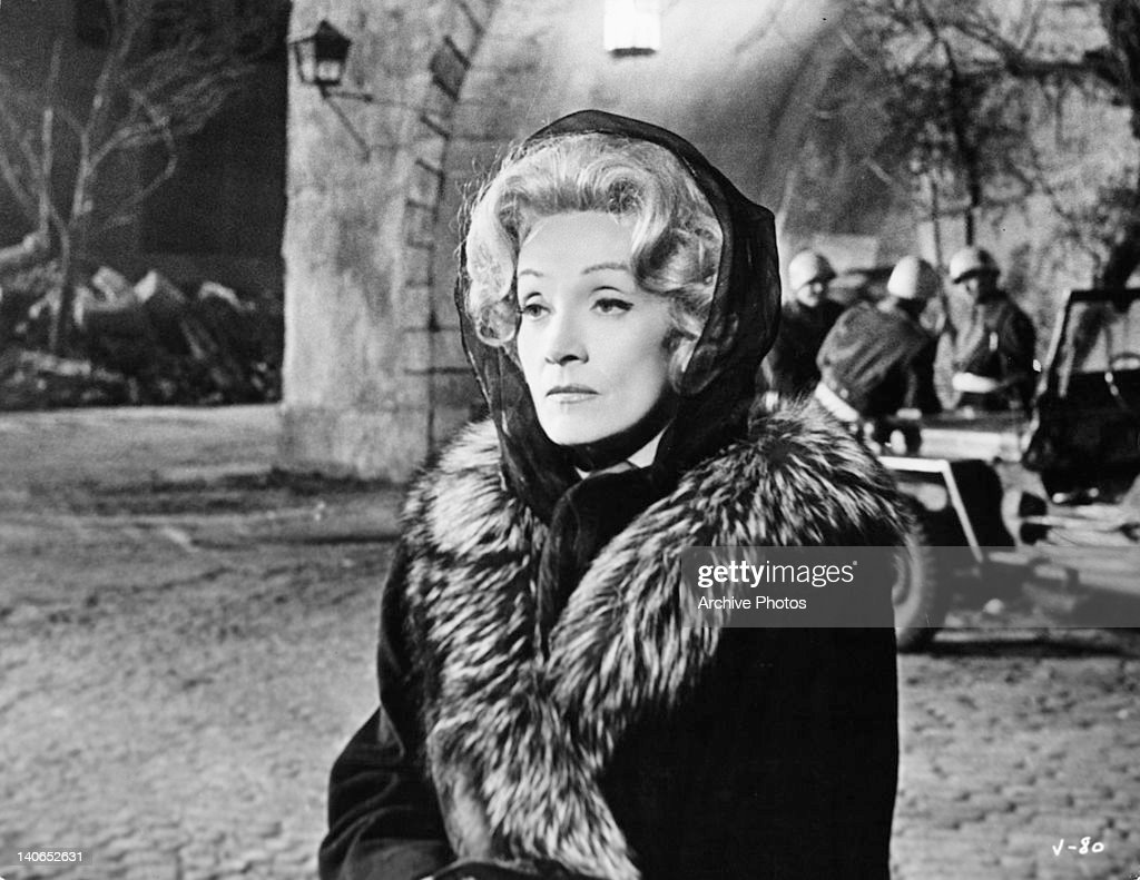 <a gi-track='captionPersonalityLinkClicked' href=/galleries/search?phrase=Marlene+Dietrich&family=editorial&specificpeople=70018 ng-click='$event.stopPropagation()'>Marlene Dietrich</a> standing outside in the night cold in a scene from the film 'Judgement At Nuremberg', 1961.