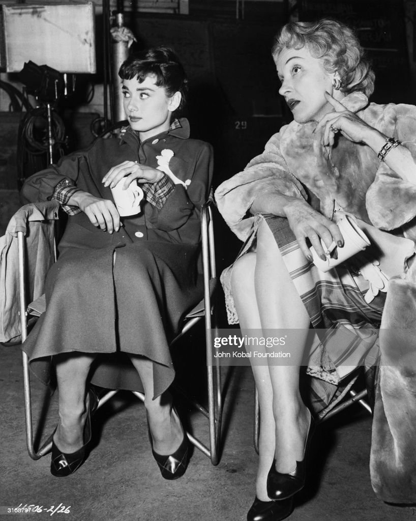 Marlene Dietrich (1901-1992) visits Audrey Hepburn (1929-1993) during a break in the filming of the 1954 hit 'Sabrina' (aka 'Sabrina Fair'), in which Hepburn stars. The film was directed by Billy Wilder.