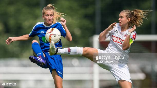 Marlene Mueller of Potsdam and AnnKathrin Vinken of Koeln fight for the ball during the B Junior Girl's German Championship Semi Final match between...