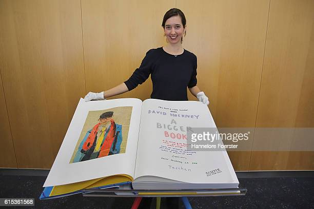Marlene Taschen shows the 2000 Euro David Hockney sumo book during the opening press conference of the 2016 Frankfurt Book Fair on October 18 2016 in...