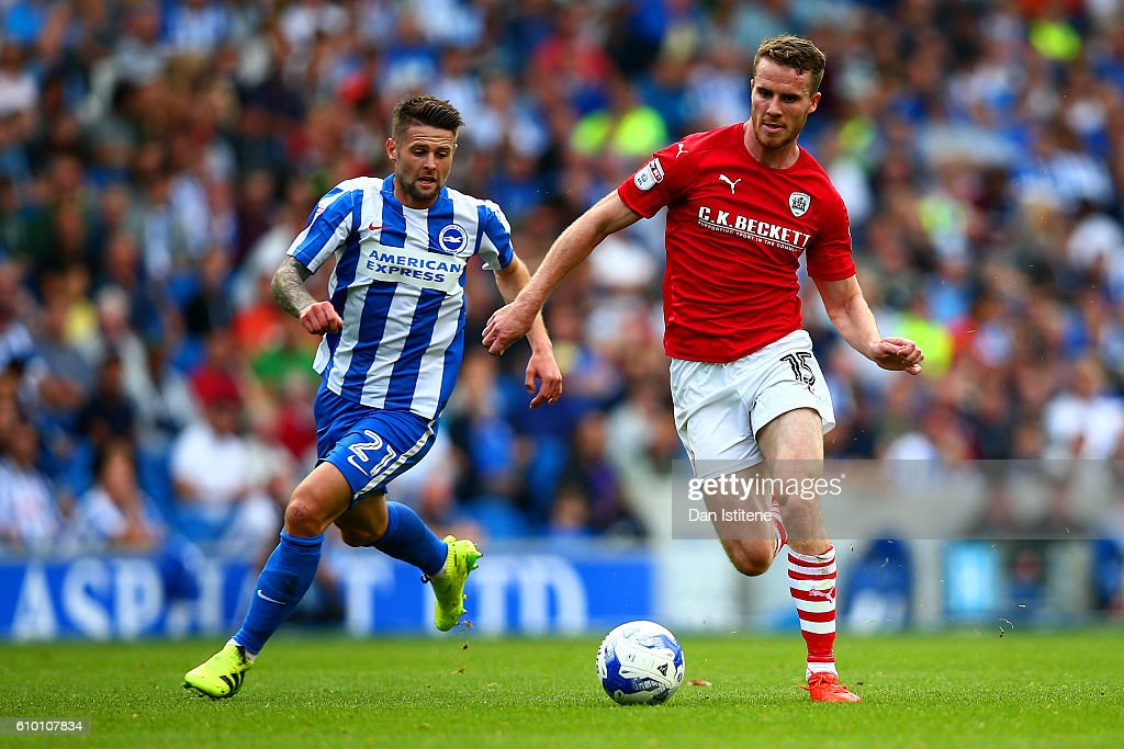 Marley Watkins of Barnsley runs with the ball under pressure from Oliver Norwood of Brighton & Hove Albion during the Sky Bet Championship match between Brighton & Hove Albion and Barnsley at Amex Stadium on September 24, 2016 in Brighton, England.
