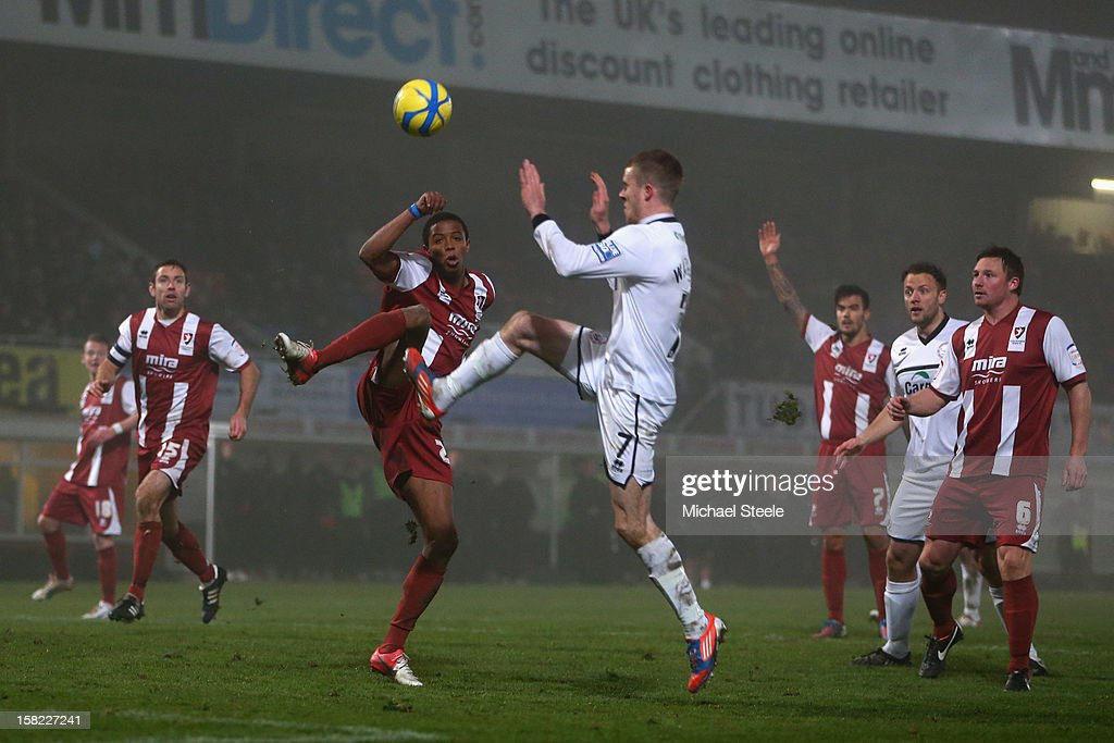 Marley Watkins (R) of Hereford United challenges with Sido Jombati (L) of Cheltenham Town during the FA Cup with Budweiser Second Round Replay match between Hereford United and Cheltenham Town at Edgar Street Athletic Ground on December 11, 2012 in Hereford, England.