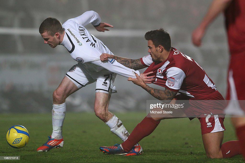 Marley Watkins (L) of Hereford United is pulled back by Marlon Pack (R) of Cheltenham Town during the FA Cup with Budweiser Second Round Replay match between Hereford United and Cheltenham Town at Edgar Street Athletic Ground on December 11, 2012 in Hereford, England.