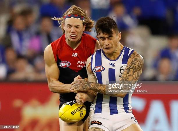 Marley Williams of the Kangaroos and Jayden Hunt of the Demons collide during the 2017 AFL round 09 match between the Melbourne Demons and the North...