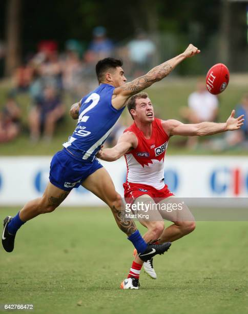 Marley Williams of the Kangaroos competes for the ball against Callum Mills of the Swans during the 2017 JLT Community Series match between the...