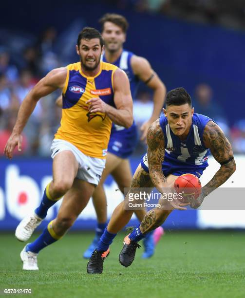 Marley Williams of the Kangaroos handballs during the round one AFL match between the North Melbourne Kangaroos and the West Coast Eagles at Etihad...
