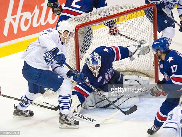 Marlies Joe Colborne tries to put a puck past Americans goalie David Leggio as the Toronto Marlies take on the Rochester Americans in the 1st round...