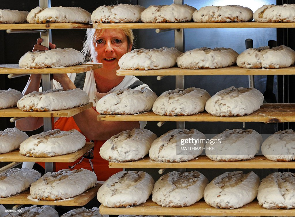 Marlies Morenz of the Morenz bakery presents the company's first Stollen fruit loaves of the season on October 10, 2012 in Dresden, eastern Germany. The company is one of 134 bakeries in the Dresden region authorized to produce the original 'Dresdner Christstollen' christmas cake, studded with almonds and raisins, flavoured with orange and lemon and finally dusted with icing sugar.