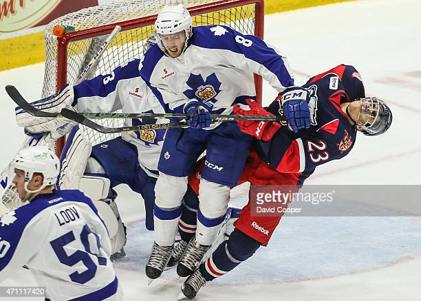TORONTO ON APRIL 25 Marlies Petter Granberg clears Griffins Andreas Athanasiou away from the front of his goalie Christopher Gibson during the first...