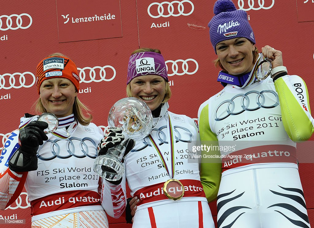 <a gi-track='captionPersonalityLinkClicked' href=/galleries/search?phrase=Marlies+Schild&family=editorial&specificpeople=209135 ng-click='$event.stopPropagation()'>Marlies Schild</a> of Austria wins the Overall Slalom World Cup, <a gi-track='captionPersonalityLinkClicked' href=/galleries/search?phrase=Tanja+Poutiainen&family=editorial&specificpeople=215271 ng-click='$event.stopPropagation()'>Tanja Poutiainen</a> of Finland takes 2nd place, Maria Riesch of Germany takes 3rd place on March 18, 2011 in Lenzerheide, Switzerland.
