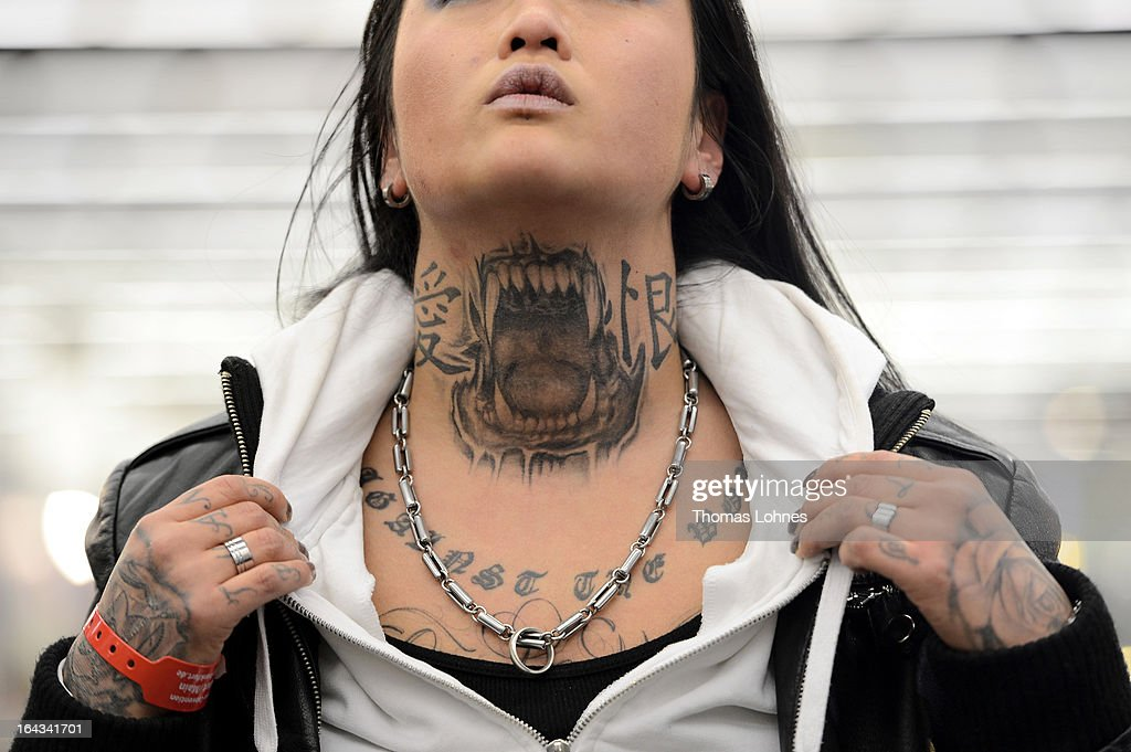 Marlin (35) shows her Pitbull-Tattoo on her neck during the International Tattoo Convention on March 22, 2013 in Frankfurt am Main, Germany. The Frankfurt tattoo convention is considered the world's biggest fair for the art of tattooing. More than 700 artists from all over the world will make more than 3,000 tattoos at the three-day show. The Hessian state laboratory has found carcinogens in some tattoo inks produced in China, causing warnings to be issued Europe-wide.