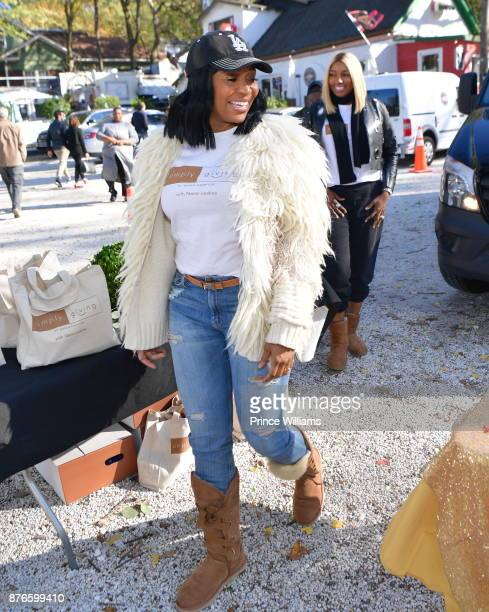 Marlo Hampton and Nene Leakes attend Thanksgiving Meal Giveaway With Nene and Marlo at Gio's on November 19 2017 in Atlanta Georgia