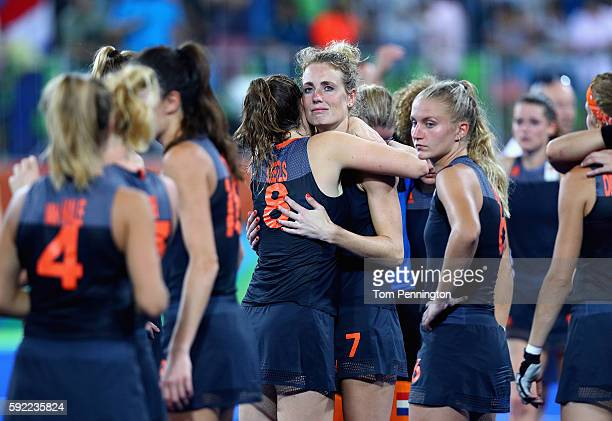 Marloes Keetels and Willemijn Bos of Netherlands react after being defeated by Great Britain in the Women's Gold Medal Match on Day 14 of the Rio...