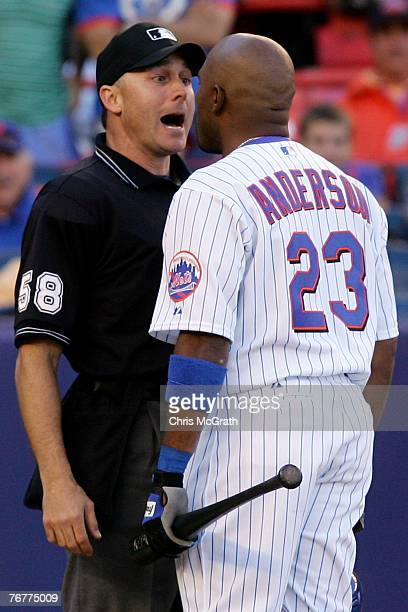 Marlon Anderson of the New York Mets argues with home plate umpire Dan Iassogna after he was called out in the nineth inning against the Philadelphia...