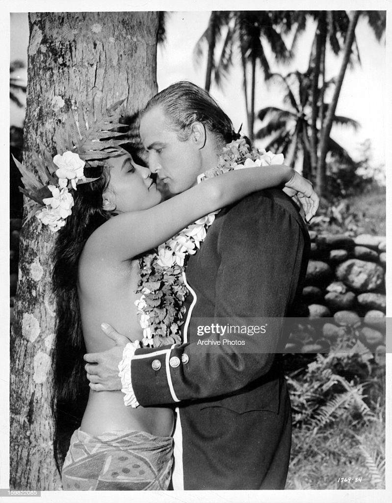 Marlon Brando and Tarita a Tahitian girl get romantically involved in a scene from the film 'Mutiny on the Bounty' 1962