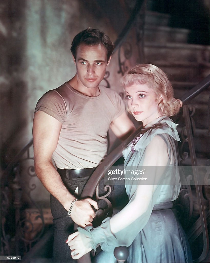 Marlon Brando (1924-2004), US actor, and Vivien Leigh (1913-1967), British actress, in a publicity still issued for the film, 'A Streetcar Named Desire', 1951. The drama, adapted from the play by Tennessee Williams (1911-1983) and directed by Elia Kazan (1909-2003), starred Brando as 'Stanley Kowalski', and Leigh as 'Blanche DuBois'.