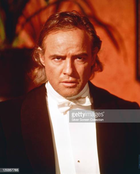 Marlon Brando US actor wearing a black jacket white shirt and white bow tie with a menacing look on his face in a publicity portrait issued for the...