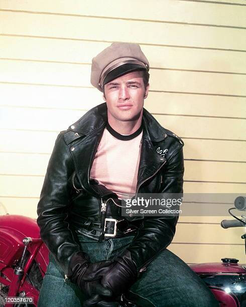 Marlon Brando US actor wearing a peaked cap and black leather jacket and gloves in a publicity portrait issued for the film 'The Wild One' USA 1953...