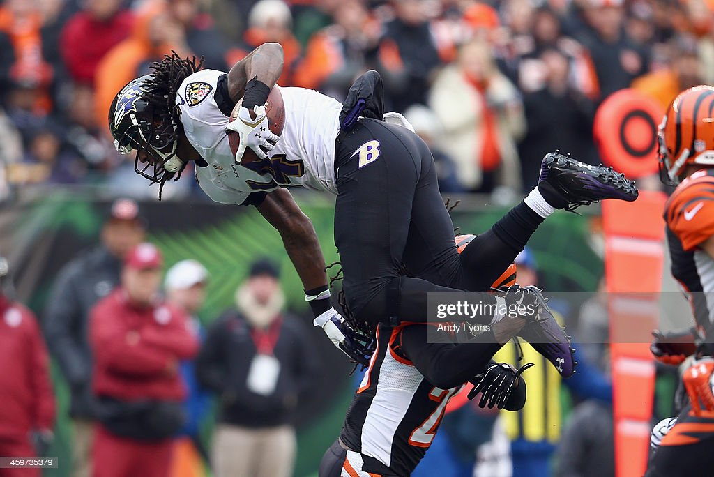 Marlon Brown #14 of the Baltimore Ravens is tackled by <a gi-track='captionPersonalityLinkClicked' href=/galleries/search?phrase=Reggie+Nelson&family=editorial&specificpeople=2141088 ng-click='$event.stopPropagation()'>Reggie Nelson</a> #20 of the Cincinnati Bengals during the 34-17 Bengals win at Paul Brown Stadium on December 29, 2013 in Cincinnati, Ohio.